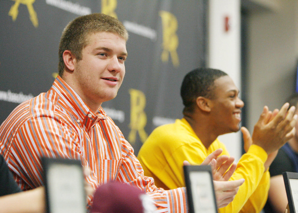 Photo - Zac Veatch (left) and Quad Ware are introduced during signing day at Broken Arrow High School on Wednesday, February 1, 2012. MATT BARNARD/Tulsa World