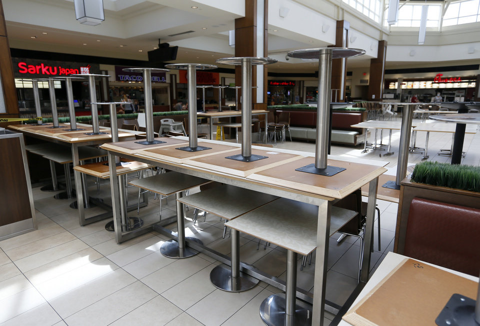 Photo - There is reduced seating in the food court at  Penn Square Mall during the re-opening of the mall after being closed because of the coronavirus pandemic, in Oklahoma City, Friday, May 1, 2020. [Nate Billings/The Oklahoman]