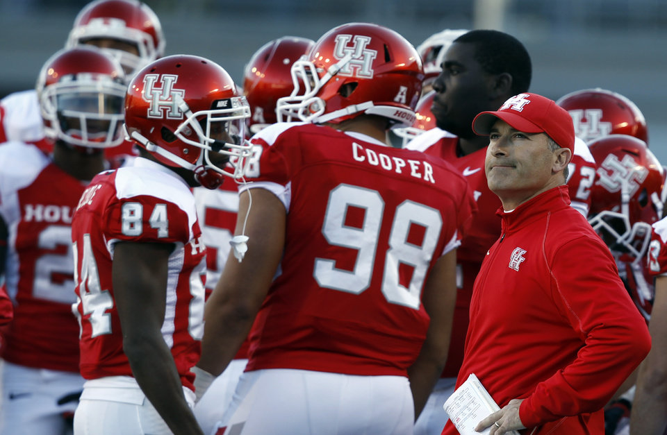 Photo - Houston coach Tony Levine watches the scoreboard as a play is under review during the second half of the BBVA Compass Bowl NCAA college football game against Vanderbilt on Saturday, Jan. 4, 2014, in Birmingham, Ala. Vanderbilt defeated Houston 41-24. (AP Photo/Butch Dill)