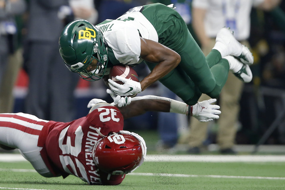 Photo - Baylor's Tyquan Thornton (81) catches the ball over Oklahoma's Delarrin Turner-Yell (32) during the Big 12 Championship Game between the University of Oklahoma Sooners (OU) and the Baylor University Bears at AT&T Stadium in Arlington, Texas, Saturday, Dec. 7, 2019. Oklahoma won 30-23. [Bryan Terry/The Oklahoman]
