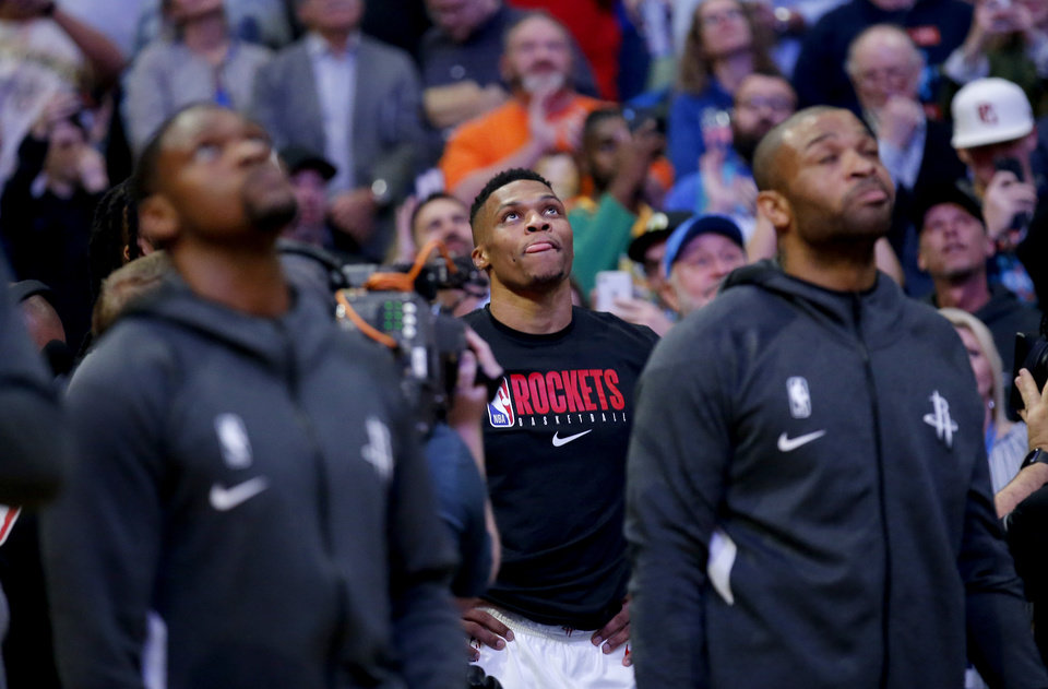 Photo - Houston's Russell Westbrook (0) watches his tribute video before the NBA basketball game between the Oklahoma City Thunder and the Houston Rockets at the Chesapeake Energy Arena in Oklahoma City,  Thursday, Jan. 9, 2020.  [Sarah Phipps/The Oklahoman]