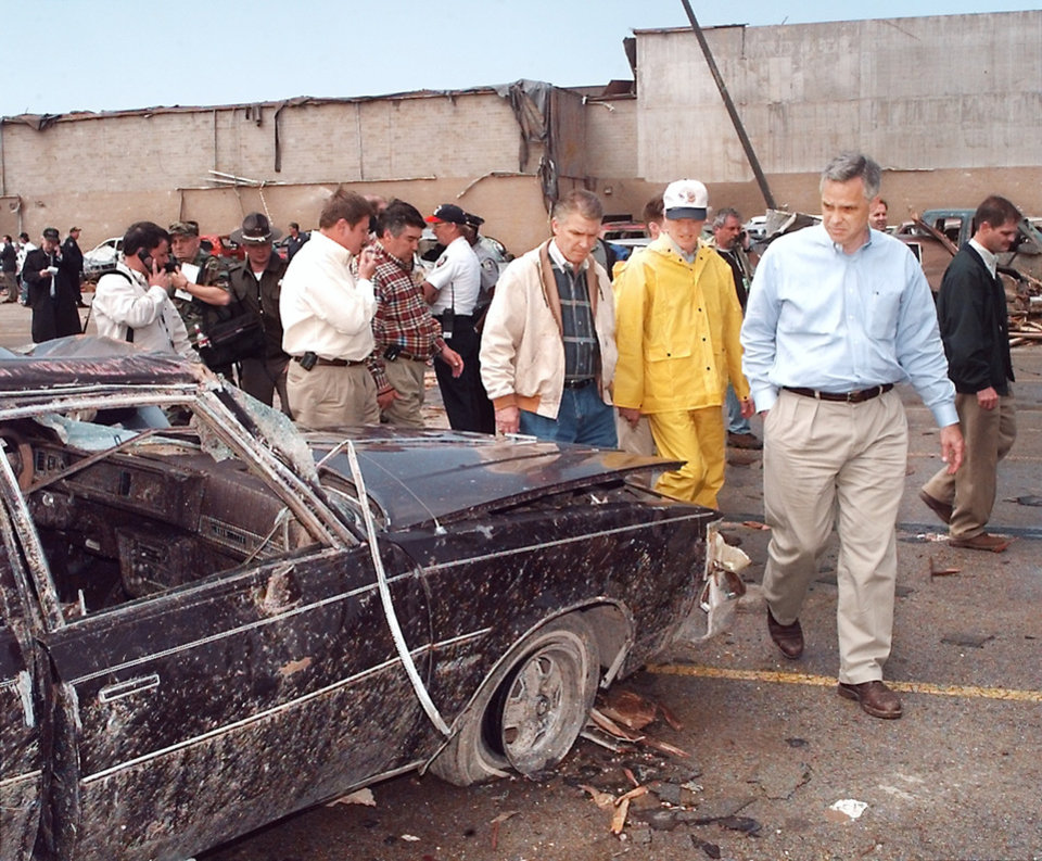 MAY 3, 1999 TORNADO: Tornado damage: L-R FEMA director James Lee Witt, Gov Frank Keating (in cap) and Oklahoma City Mayor Kirk Humphreys out front of Westmoore High School looking over the damage.
