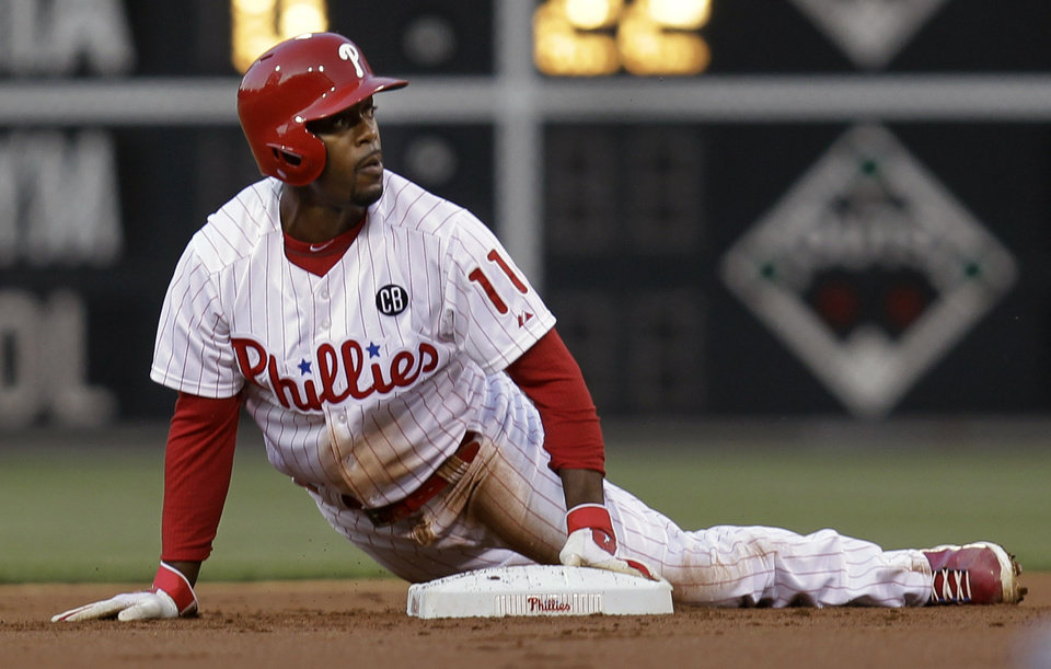 Photo - Philadelphia Phillies' Jimmy Rollins is safe on a steal at second in the first inning of a baseball game against the Washington Nationals, Saturday, May 3, 2014, in Philadelphia. (AP Photo/Laurence Kesterson)