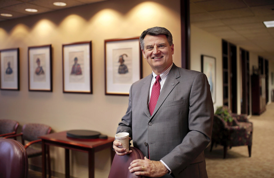 Photo -  Tony Shinn, senior vice president of Bank of America, and market president for Global Commercial Banking, is seen in his downtown Oklahoma City office. Photo by Jim Beckel, The Oklahoman   Jim Beckel -  THE OKLAHOMAN