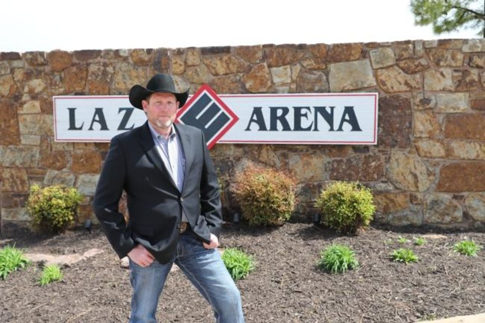 Photo -  PBR's chief executive officer Sean Gleason poses outside the Lazy E Arena near Guthrie, where the PBR will be broadcasting bull riding events. [PHOTO BY ANDY WATSON]