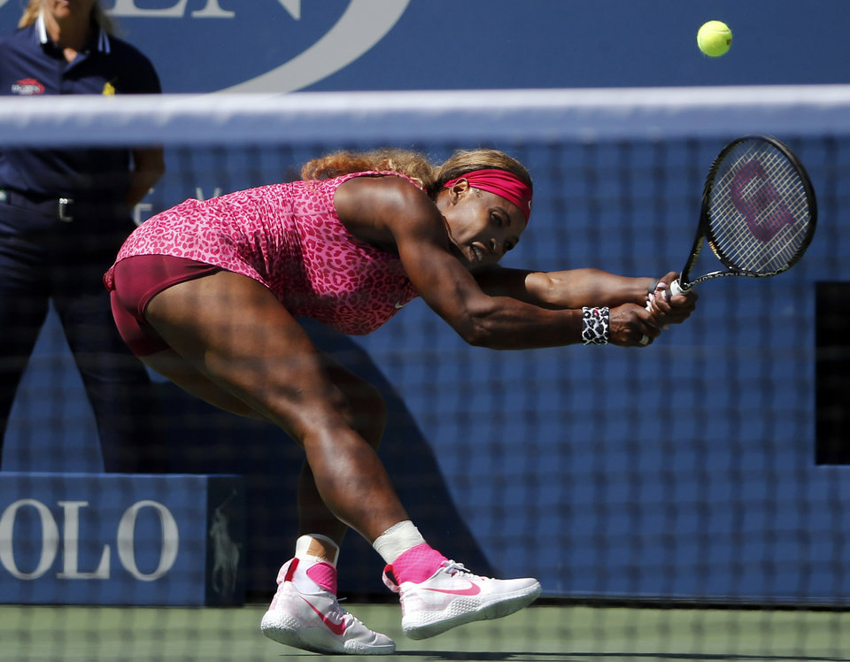 Photo - Serena Williams, of the United States, follows through as she returns a shot during the second round of the 2014 U.S. Open tennis tournament, Thursday, Aug. 28, 2014, in New York. (AP Photo/Elise Amendola)