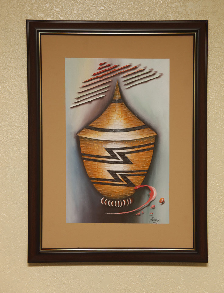 Photo - A Rwandan painting that hangs in Terry Neese's Oklahoma City offices. Through the Institute for Economic Empowerment of Women and the Peace Through Education program, Neese helps women in Rwanda and Afghanistan build their own businesses.  DOUG HOKE - THE OKLAHOMAN