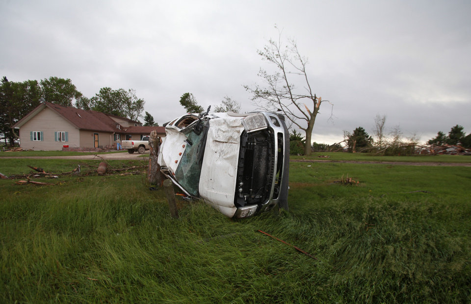Duane Barkema's truck sits on its side in Alexander, Iowa, after a tornado was reported in the area on Wednesday, June 12, 2013, in Alexander and Belmond. (AP Photo/The Des Moines Register, Bryon Houlgrave)