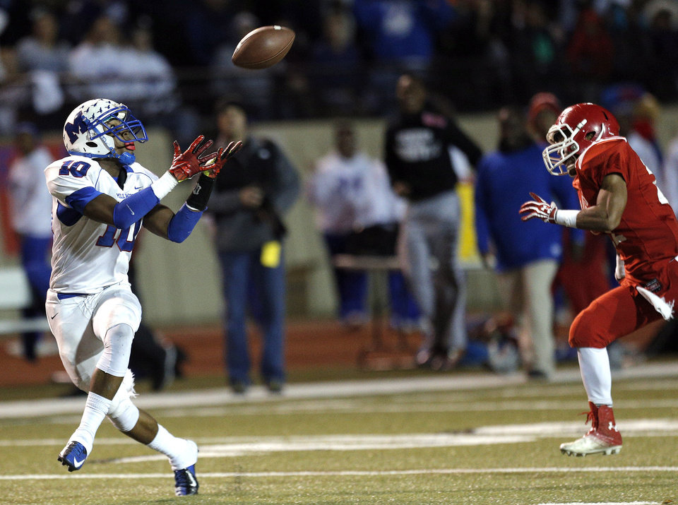 Photo - Millwood's Alfonzo McMillian makes a touchdown catch as Davis' Peyton Ross chases him down during the Class 2A state football championship game between Davis and Millwood at Moore High School in Moore, Okla.,  Thursday, Dec. 19, 2013. Photo by Sarah Phipps, The Oklahoman