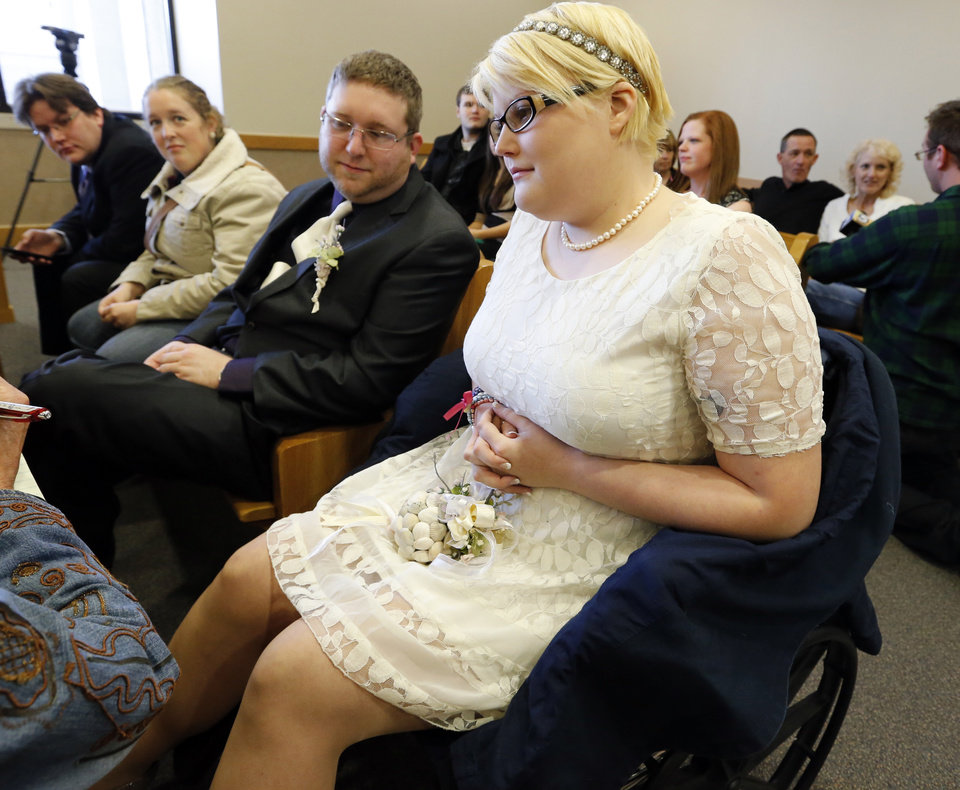 Todd Tucker and Elizabeth Brand wait their turn as couples take advantage of an easy to remember date (11-12-13) for their wedding day in District Judge Tracy Schumacher's courtroom on Tuesday, Nov. 12, 2013 in Norman, Okla.  Judge Thad Balkman jointed her to decrease the load.  Photo by Steve Sisney, The Oklahoman