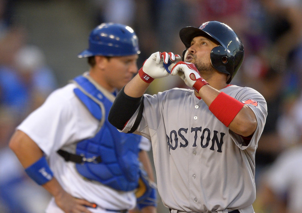 Photo - Boston Red Sox's Shane Victorino, right, points to the sky after hitting a solo home run as Los Angeles Dodgers catcher A.J. Ellis looks on during the seventh inning of their baseball game, Sunday, Aug. 25, 2013, in Los Angeles.  (AP Photo/Mark J. Terrill)