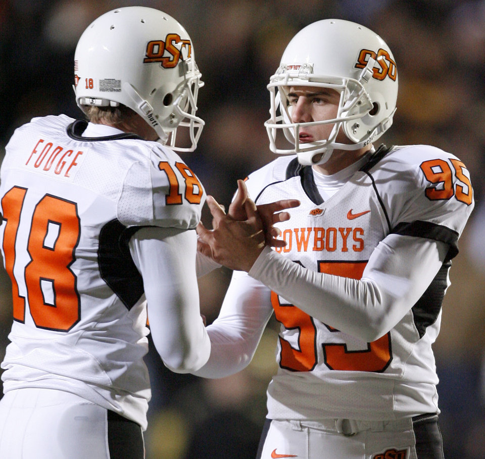 Photo - OSU's Chris Donaldson, right, celebrates with Matt Fodge after a field goal in the college football game between Oklahoma State University and the University of Colorado at Folsom Field in Boulder, Colo., Saturday, Nov. 15, 2008. BY BRYAN TERRY, THE OKLAHOMAN
