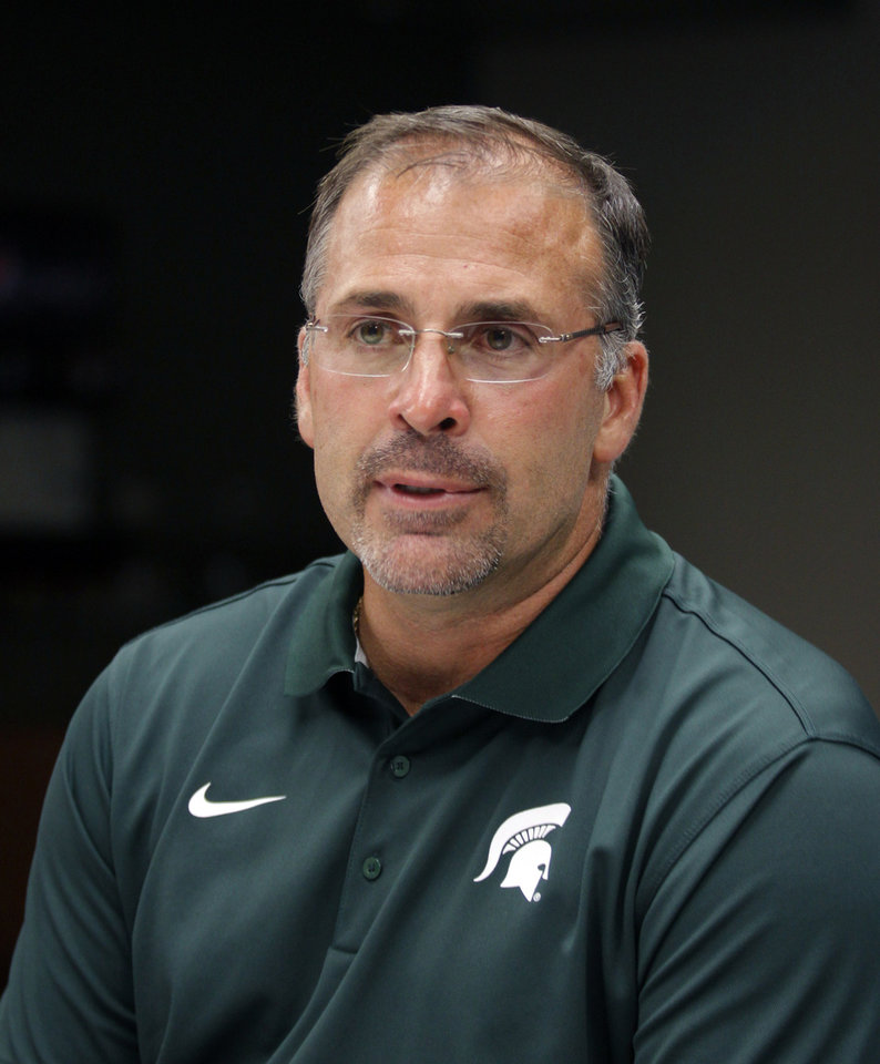 Photo - Michigan State defensive coordinator Pat Narduzzi talks to the media during the team's NCAA college football media day, Monday, Aug. 4, 2014, in East Lansing, Mich. (AP Photo/Al Goldis)