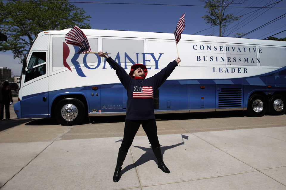 Photo -   Betty Merrow, 79, cheers for Republican presidential candidate, former Massachusetts Gov. Mitt Romney at a campaign stop in Lansing, Mich., Tuesday, May 8, 2012. (AP Photo/Jae C. Hong)