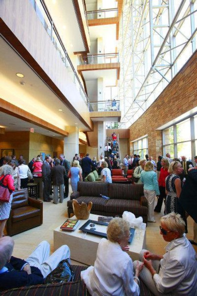 Guests gather in the atrium of the Peggy and Charles Stephenson Oklahoma Cancer Center on Thursday after a dedication ceremony. The building is open for tours from 9 a.m. to 3:30 p.m. Friday. Photo by David McDaniel, The Oklahoman  ORG XMIT: KOD <strong>David McDaniel - The Oklahoman</strong>