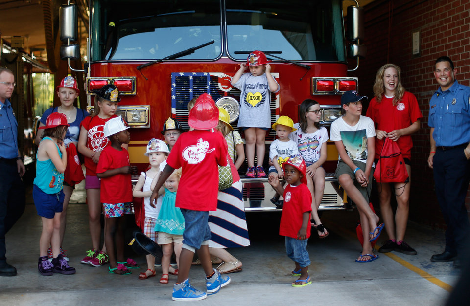 Photo -  Children gather to pose for a group photo on a Warr Acres fire truck on Wednesday, July 24, 2013. Photo by Bryan Terry, The Oklahoman