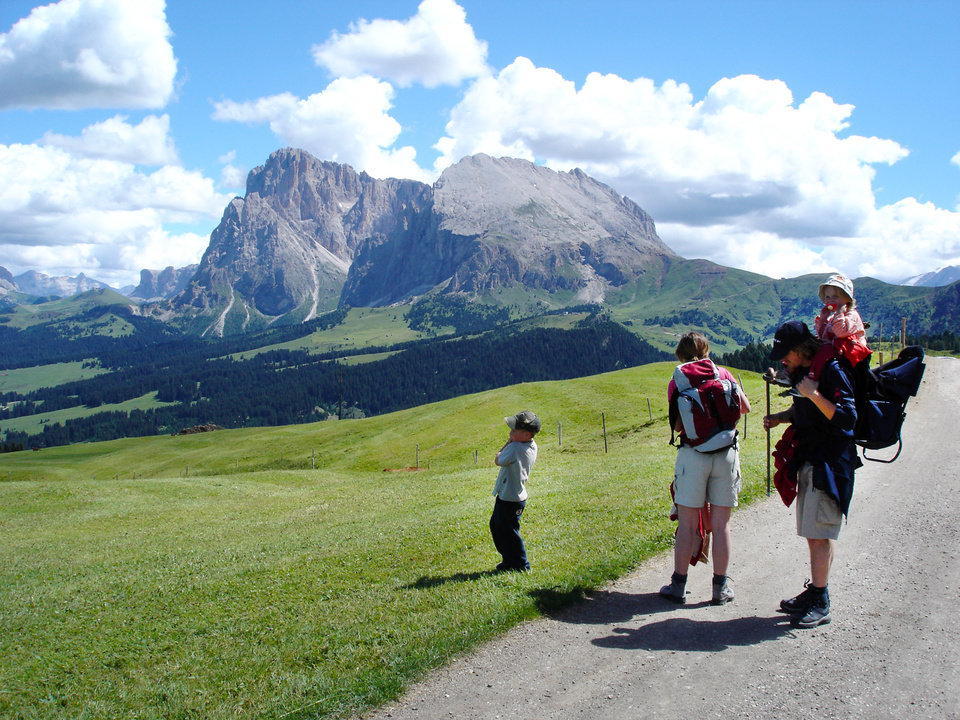 A family gets ready for a hike in Italy's Alpe di Siusi--the largest alpine meadow in Europe.   (photo credit: Rick Steves)