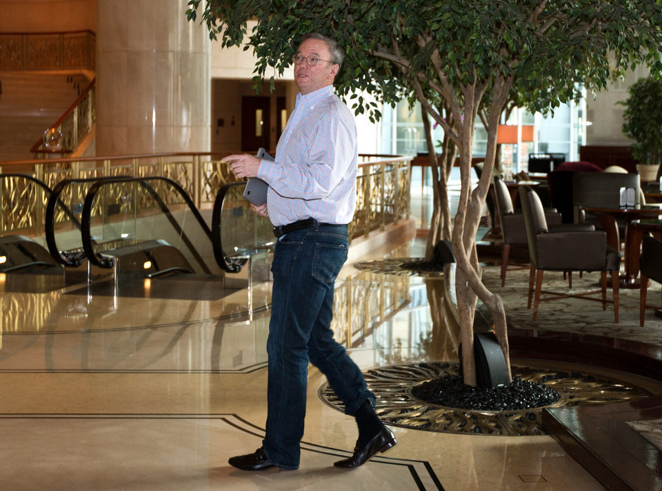 Photo - Google's executive chairman Eric Schmidt walks away from a hotel lounge after a meeting with former New Mexico Gov. Bill Richardson in Beijing Monday, Jan. 7, 2013. Schmidt, who is part of a delegation led by Richardson, is scheduled to leave Monday on a commercial flight bound for North Korea, a country considered to have the world's most restrictive Internet policies. (AP Photo/Andy Wong)