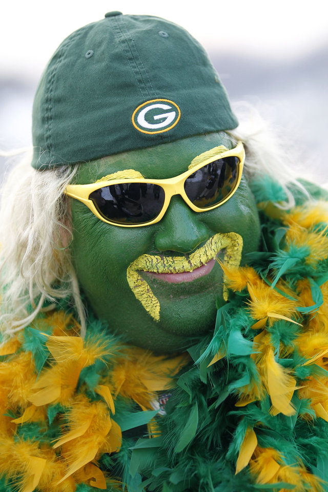 Photo - Brad Borchard, of Iron Mountain, Mich., is seen dressed up before an NFL wild card playoff football game between the Green Bay Packers and the Minnesota Vikings Saturday, Jan. 5, 2013, in Green Bay, Wis. (AP Photo/Mike Roemer)