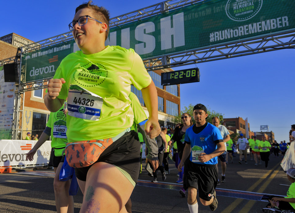 Photo - Cassandra Cookson finishes the 5K race during the Oklahoma City Marathon in Oklahoma City, Okla. on Sunday, April 29, 2018.  . Photo by Chris Landsberger, The Oklahoman