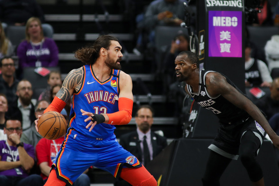 Photo - Jan 29, 2020; Sacramento, California, USA; Oklahoma City Thunder center Steven Adams (12) grabs a rebound against Sacramento Kings center Dewayne Dedmon (13) during the first quarter at Golden 1 Center. Mandatory Credit: Sergio Estrada-USA TODAY Sports