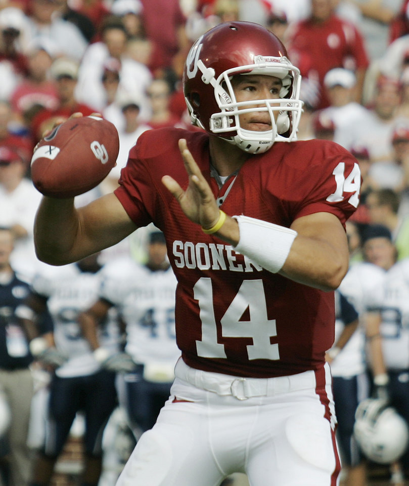 Photo - ** FILE ** University of Oklahoma quarterback Sam Bradford throws against Utah State in this file photo shot in the second quarter of a college football game in Norman, Okla., in this Sept. 15, 2007 file photo. The nation's top-rated passer, Bradford was nearly flawless in his first four games. OU takes on Texas on Saturday, Oct. 6 in the Red River Rivalry game.(AP Photo/Sue Ogrocki) ORG XMIT: OKSO104