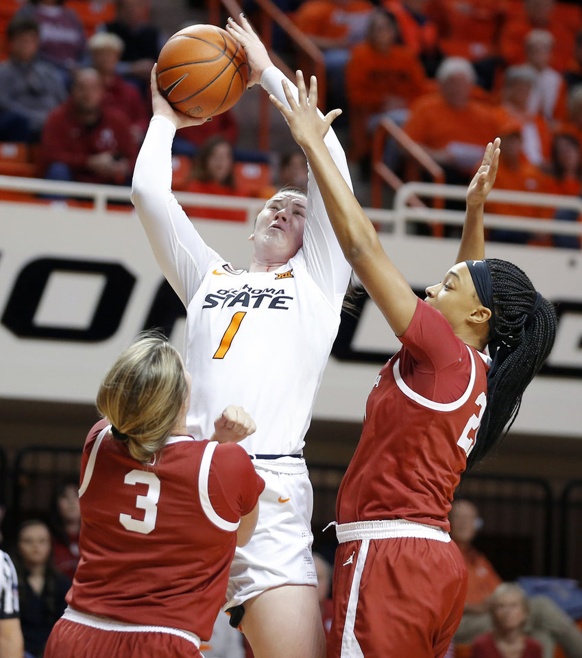 Photo - Oklahoma State's Kassidy De Lapp (1) attempts a shot between Oklahoma's Mandy Simpson (3) and Nydia Lampkin (21) during a women's Bedlam college basketball game between the Oklahoma State University Cowgirls (OSU) and the University of Oklahoma Sooners (OU) at Gallagher-Iba Arena in Stillwater, Okla., Wednesday, Jan. 8, 2020. [Bryan Terry/The Oklahoman]