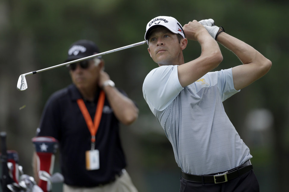 Jesse Smith tees off on the eighth hole during practice for the U.S. Open golf tournament at Merion Golf Club, Wednesday, June 12, 2013, in Ardmore, Pa. (AP Photo/Julio Cortez)