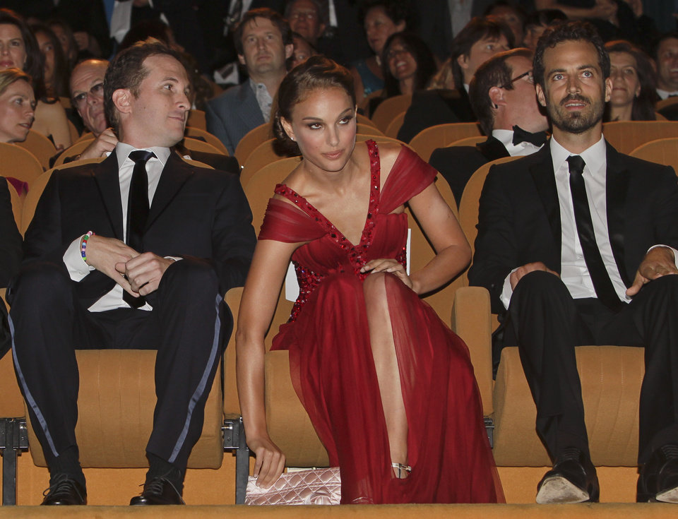 Photo - From left, director Darren Aronofsky and actors Natalie Portman, and Benjamin Millepied attend the opening ceremony at the 67th edition of the Venice Film Festival in Venice, Italy, Wednesday, Sept. 1, 2010. (AP Photo/Andrew Medichini) ORG XMIT: VEN319
