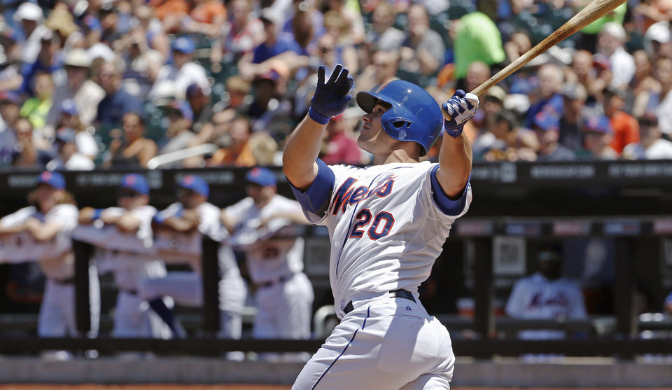 Photo - New York Mets Anthony Recker hits a first-inning three-run home run off Texas Rangers starting pitcher Nick Tepesch in a baseball game in New York, Sunday, July 6, 2014. (AP Photo/Kathy Willens)