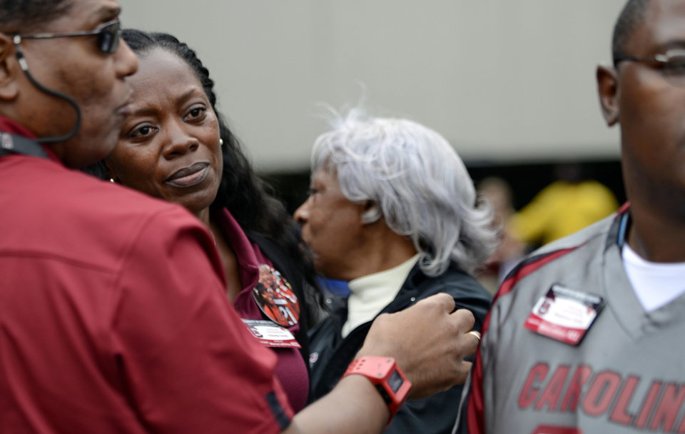 Photo -   Yolanda Smith, second from left, the mother of South Carolina running back Marcus Lattimore watches from the sidelines after he was injured on a hit by Tennessee's Eric Gordon during the first half of an NCAA college football game, Saturday, Oct. 27, 2012 at Williams-Brice Stadium in Columbia, S.C.(AP Photo/Richard Shiro)