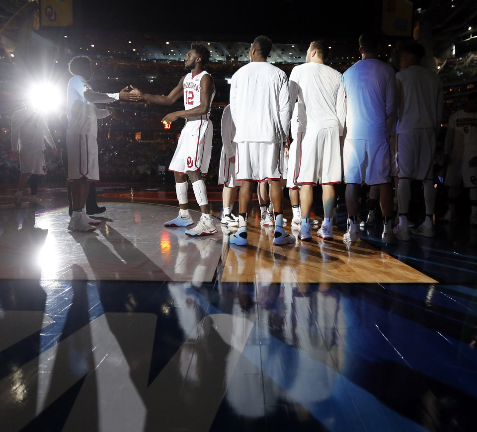 Photo - Oklahoma's Khadeem Lattin (12) is introduced before the national semifinal between the Oklahoma Sooners (OU) and the Villanova Wildcats in the Final Four of the NCAA Men's Basketball Championship at NRG Stadium in Houston, Saturday, April 2, 2016. Photo by Nate Billings, The Oklahoman