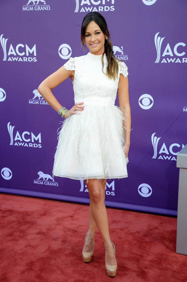 Singer Kacey Musgraves arrives at the 48th Annual Academy of Country Music Awards at the MGM Grand Garden Arena in Las Vegas on Sunday, April 7, 2013. (Photo by Al Powers/Invision/AP) ORG XMIT: NVPM242