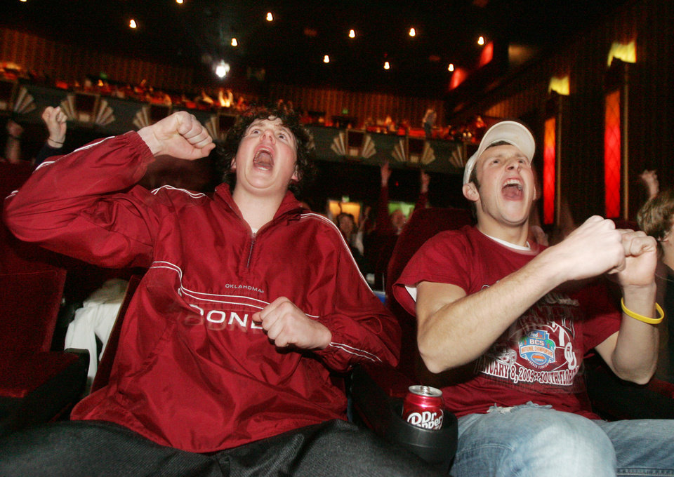 Photo - 17yr old Conner Davy and 16yr old Tyler Hewett of Washington, watch the University of Oklahoma and the Florida Gators play in the BCS National Championship football game at the Warren Theatre in Moore , Okla. January  08, 2009.  BY STEVE GOOCH, THE  OKLAHOMAN