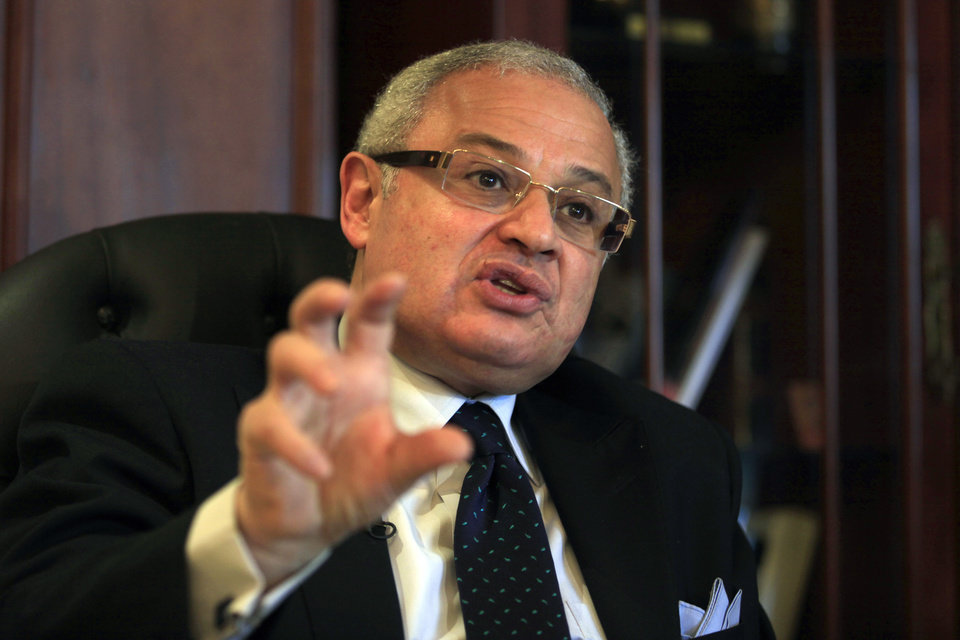Egypt\'s minister of tourism, Hesham Zaazoua, speaks during an interview with the Associated Press at his office in Cairo, Egypt Thursday, March 28, 2013. Egypt\'s tourism minister says Iranian tourists would help shore up Egypt\'s dilapidated tourism industry and would not pose security challenge to the nation. Zaazoua says he does not worry that visiting Iranians would try to export a revolution to Egypt. (AP Photo/Khalil Hamra)