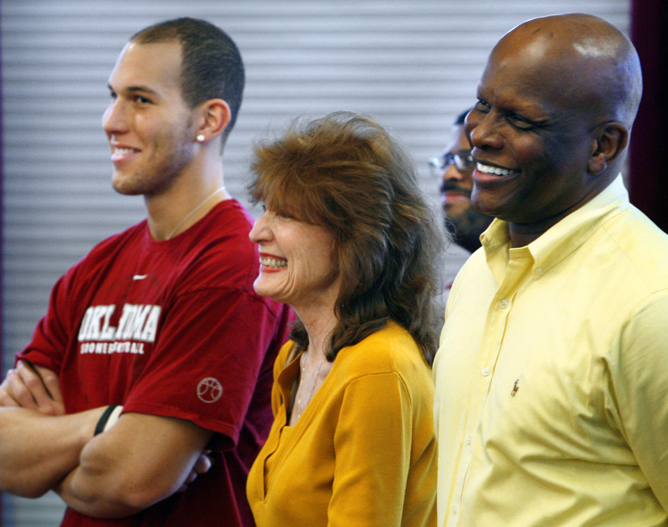Photo - Taylor, Gail and Tommy Griffin watch as their brother/son, University of Oklahoma basketball star Blake Griffin, announces he will leave the Sooner team for the professional draft in Norman, Okla. on Tuesday, April 7, 2009.   