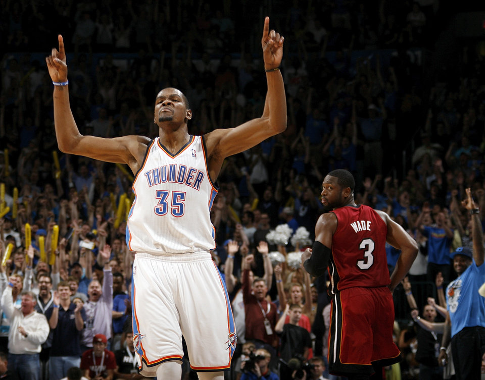Oklahoma City's Kevin Durant (35) reacts after a three-point shot in the fourth quarter as Miami's Dwyane Wade (3) look back during the NBA basketball game between the Miami Heat and the Oklahoma City Thunder at Chesapeake Energy Arena in Oklahoma City, Sunday, March 25, 2012. Oklahoma City won, 103-87. Photo by Nate Billings, The Oklahoman