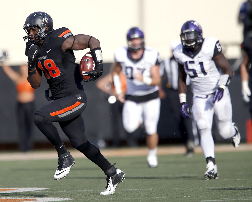Photo - Oklahoma State's Blake Jackson (18) runs after making a catch as TCU's Jon Koontz (97) and Kenny Cain (51) chase him down during a college football game between Oklahoma State University (OSU) and Texas Christian University (TCU) at Boone Pickens Stadium in Stillwater, Okla., Saturday, Oct. 27, 2012. Photo by Sarah Phipps, The Oklahoman