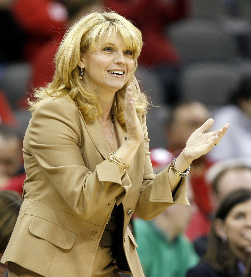 Photo - OU coach Sherri Coale cheers for her team during the Sweet 16 round of the NCAA women's  basketball tournament in Kansas City, Mo., on Sunday, March 28, 2010. 