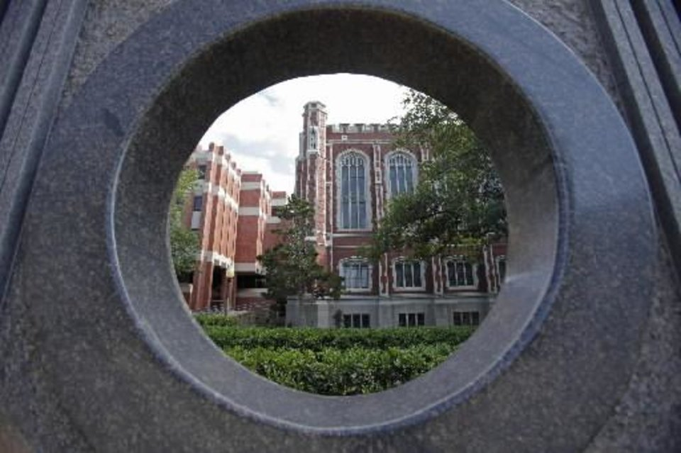 "University of Oklahoma ( OU) library as seen thorough the Jesus Moroles sculpture ""Disc Ruin"" on Wednesday, July 13, 2011, in Norman, Okla. Photo by Steve Sisney, The Oklahoman"