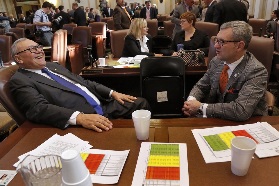 Photo - Rep. Chuck Hoskin, left, and Rep. Minority Floor Leader Ben Sherrer speak as they wait for Gov. Fallin to arrive before the start of  the Oklahoma Legislature's 2016 State-of-the-State Address by Gov. Mary Fallin in the chamber of the House of Representatives at the Oklahoma state capitol on Monday, Feb. 1, 2016, in Oklahoma City, Okla. Photo by Jim Beckel, The Oklahoman