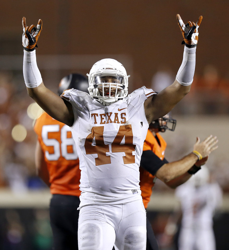 Photo - Texas' Jackson Jeffcoat (44) celebrates during a college football game between Oklahoma State University (OSU) and the University of Texas (UT) at Boone Pickens Stadium in Stillwater, Okla., Saturday, Sept. 29, 2012. Oklahoma State lost 41-36. Photo by Bryan Terry, The Oklahoman