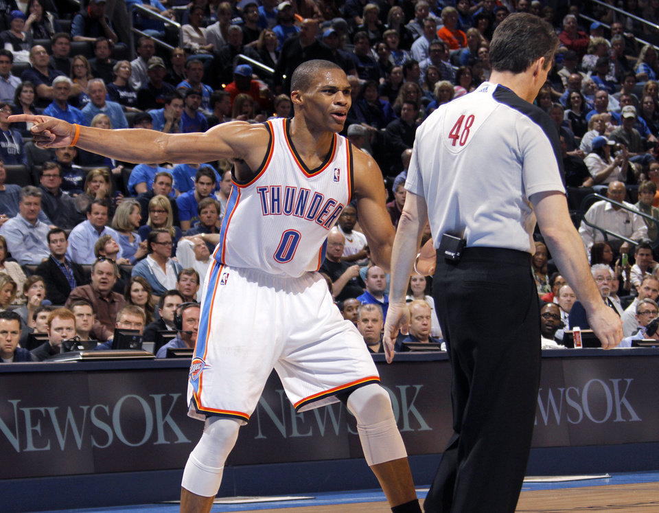 Photo - Oklahoma City Thunder point guard Russell Westbrook (0) argues a technical with the official during the NBA basketball game between the Oklahoma City Thunder and the Phoenix Suns at the Chesapeake Energy Arena on Wednesday, March 7, 2012 in Oklahoma City, Okla.  Photo by Chris Landsberger, The Oklahoman