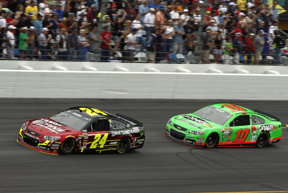 Photo - Jeff Gordon (24) and Danica Patrick (10) lead during early laps of the NASCAR Daytona 500 Sprint Cup Series auto race at Daytona International Speedway, Sunday, Feb. 24, 2013, in Daytona Beach, Fla. (AP Photo/Terry Renna)