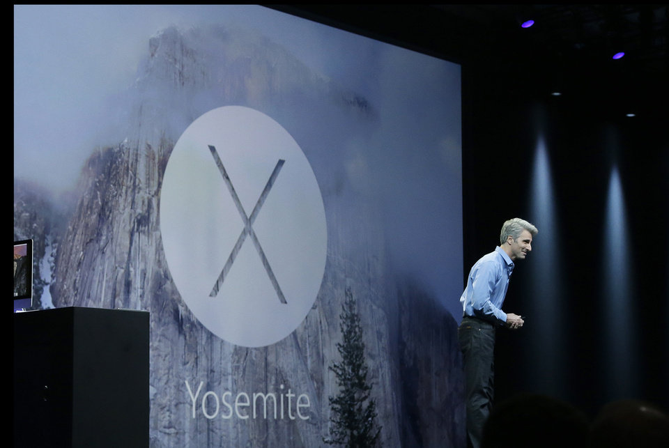 Photo - Apple senior vice president of Software Engineering Craig Federighi introduces the Yosemite operating system during the Apple Worldwide Developers Conference in San Francisco, Monday, June 2, 2014. (AP Photo/Jeff Chiu)