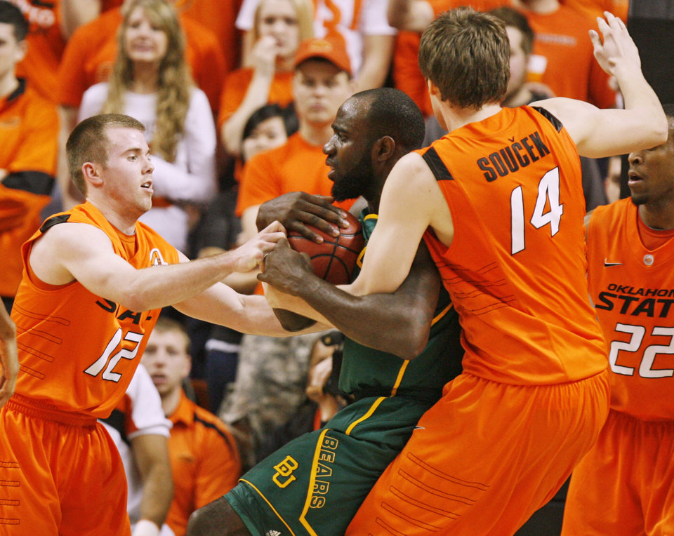 Photo - OSU's Keiton Page (12) and Marek Soucek (14) get tied up with Quincy Acy (4) of Baylor in the first half of a men's college basketball game between the Oklahoma State University Cowboys and the Baylor University Bears at Gallagher-Iba Arena in Stillwater, Okla., Saturday, Feb. 4, 2012. Photo by Nate Billings, The Oklahoman