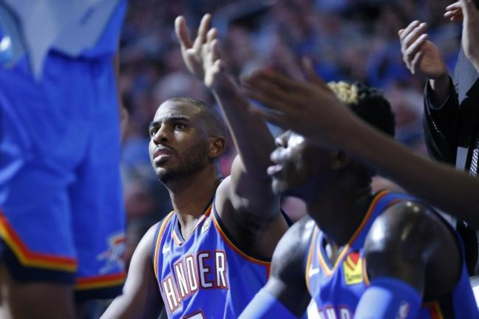 Photo -  Chris Paul slaps hands as he sits down during a timeout on Friday during the Thunder's 127-119 win against the 76ers. [Bryan Terry/The Oklahoman]