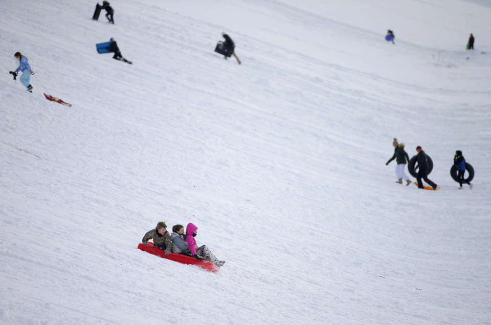 Photo - Sledders race down a hill along W Hefner Road in Oklahoma City after a winter storm dropped another layer of snow in Oklahoma City, Wednesday, Feb. 17, 2021. [Bryan Terry/The Oklahoman]