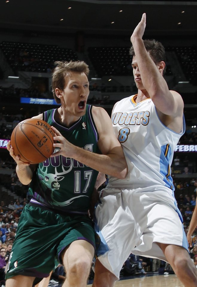 Photo - Milwaukee Bucks forward Mike Dunleavy, left, works against Denver Nuggets forward Danilo Gallinari, of Italy, during the first quarter of an NBA basketball game in Denver on Tuesday, Feb. 5, 2013. (AP Photo/David Zalubowski)
