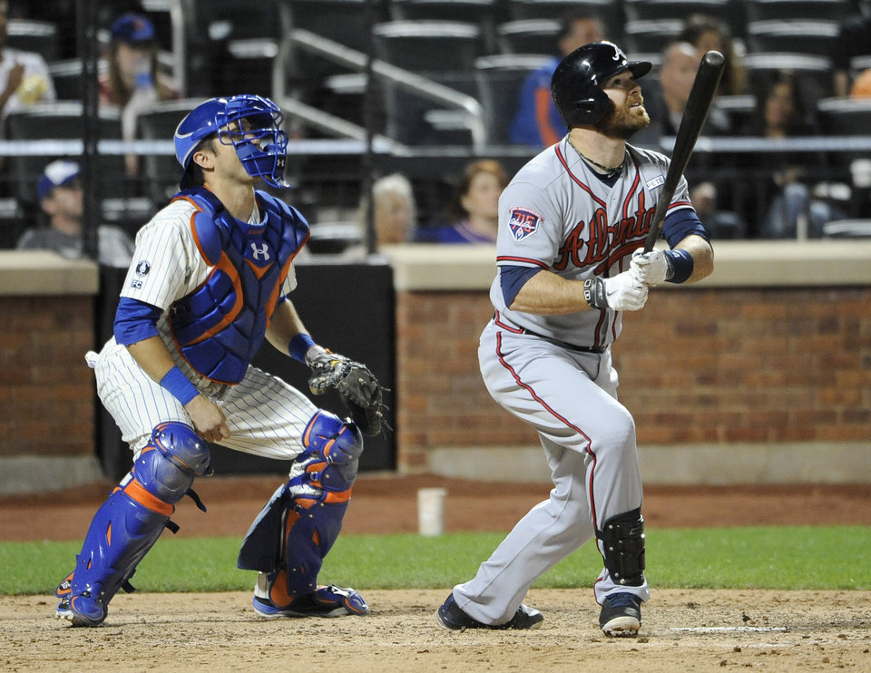 Photo - New York Mets catcher Travis d'Arnaud and Atlanta Braves' Ryan Doumit watch Doumit's two-run home run off New York Mets relief pitcher Daisuke Matsuzaka in the ninth inning of a baseball game at Citi Field on Thursday, Aug. 28, 2014, in New York. (AP Photo/Kathy Kmonicek)